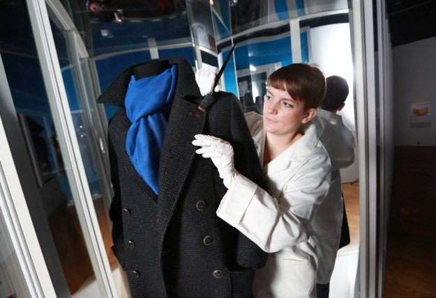 Checking the famous Cumberbatch Belstaff, which is on display at the Museum of London