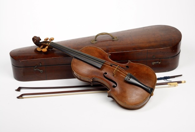 A Violin made by Duke of London, era-appropriate for Sherlock, but not the Strad he picked up for a song along Tottenham Court Road.